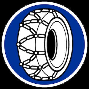 blaues, rundes Schild mit Reifen mit Schneeketten